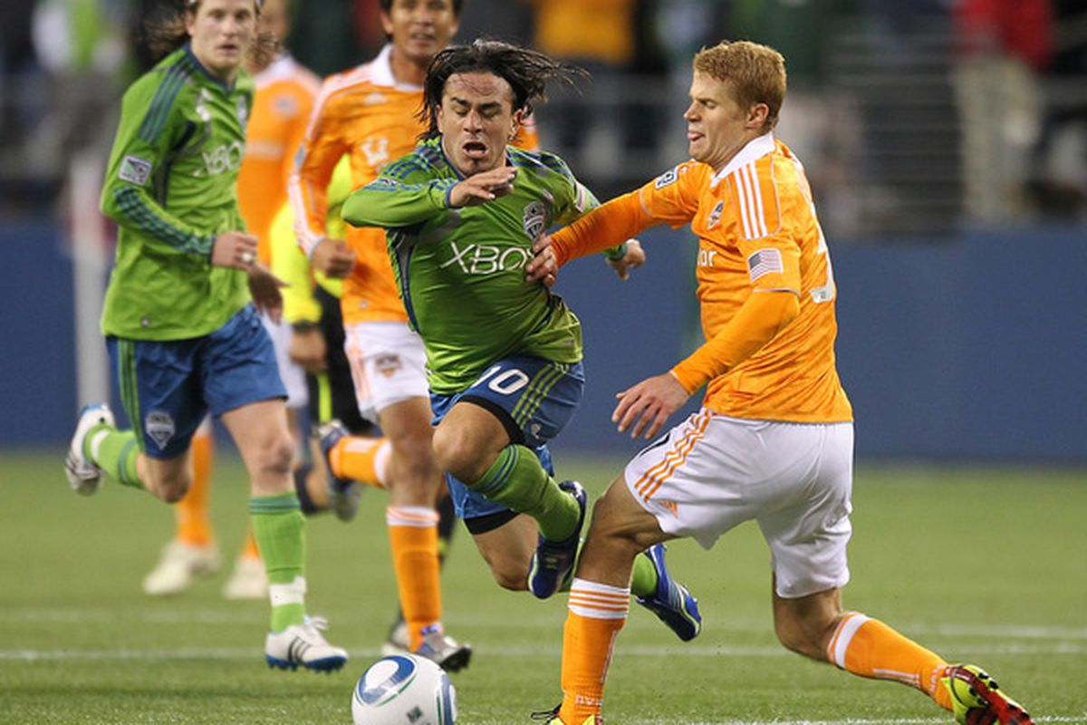 SEATTLE - MARCH 25:  Mauro Rosales #10 of the Seattle Sounders FC battles Andrew Hainault #31 of the Houston Dynamo at Qwest Field on March 25, 2011 in Seattle, Washington. (Photo by Otto Greule Jr/Getty Images)