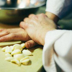 Crushing garlic for the marinade.