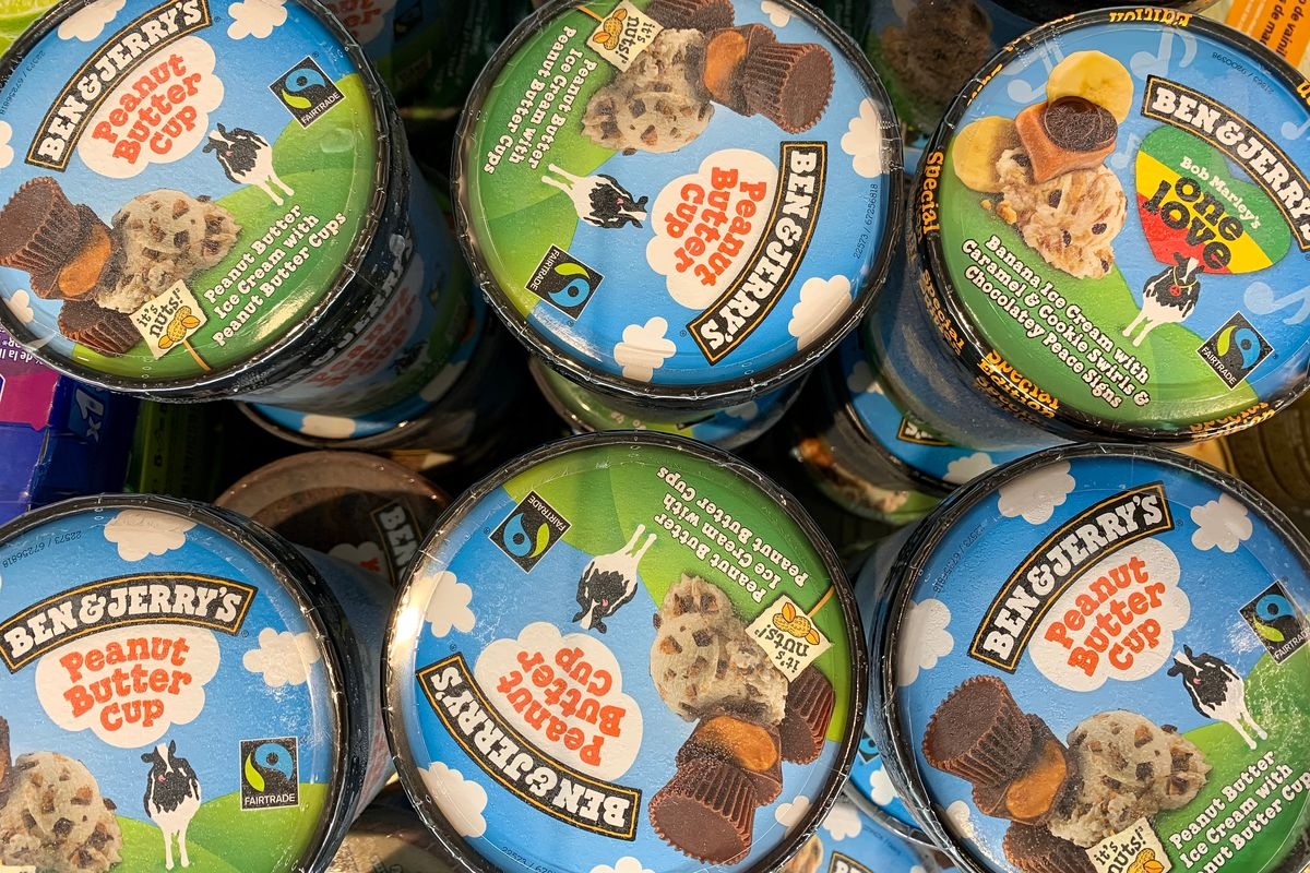 Cartons of Ben & Jerry's in a grocery store freezer