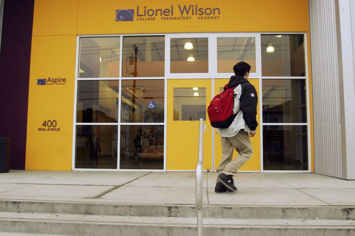 A student arrives for classes at the Lionel Wilson College Preparatory Academy, an Aspire charter school, located in the Oakland Unified School District. (Photo by Kim Kulish/Corbis via Getty Images)