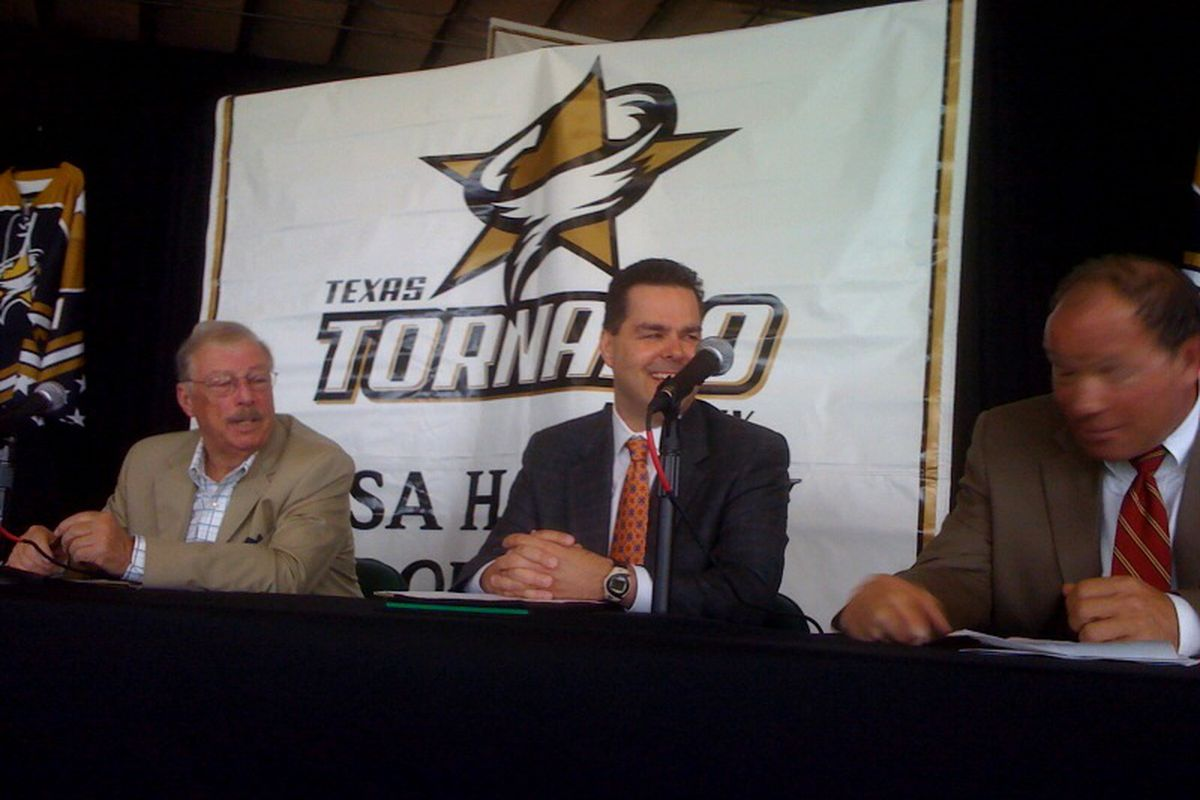 From left to right: new owner Bill Yuill, Consolidated Sports Holdings executive vice president Gary Gelinas, and Dallas Stars president Jeff Cogen. Mr. Cogen's face isn't naturally blurry, I'm just not very skilled with my iPhone camera...