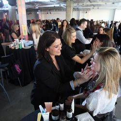 Lauren Mager from Philosophy, left,  applies makeup to Jade Bonomo during the Nordstrom's Beauty Bash during the City Creek Center opening Thursday morning, March 22, 2012.