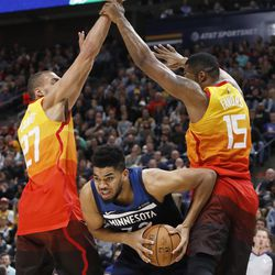 Minnesota Timberwolves' Karl-Anthony Towns works between Utah Jazz's Rudy Gobert (27) and Derrick Favors (15) during the first half of an NBA basketball game Friday, March 2, 2018, in Salt Lake City. (AP Photo/Kim Raff)
