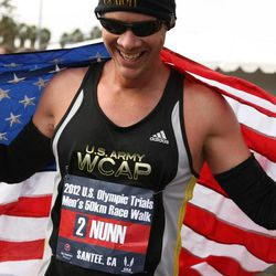 John Nunn drapes an American flag over his shoulder after winning the qualifying trials.