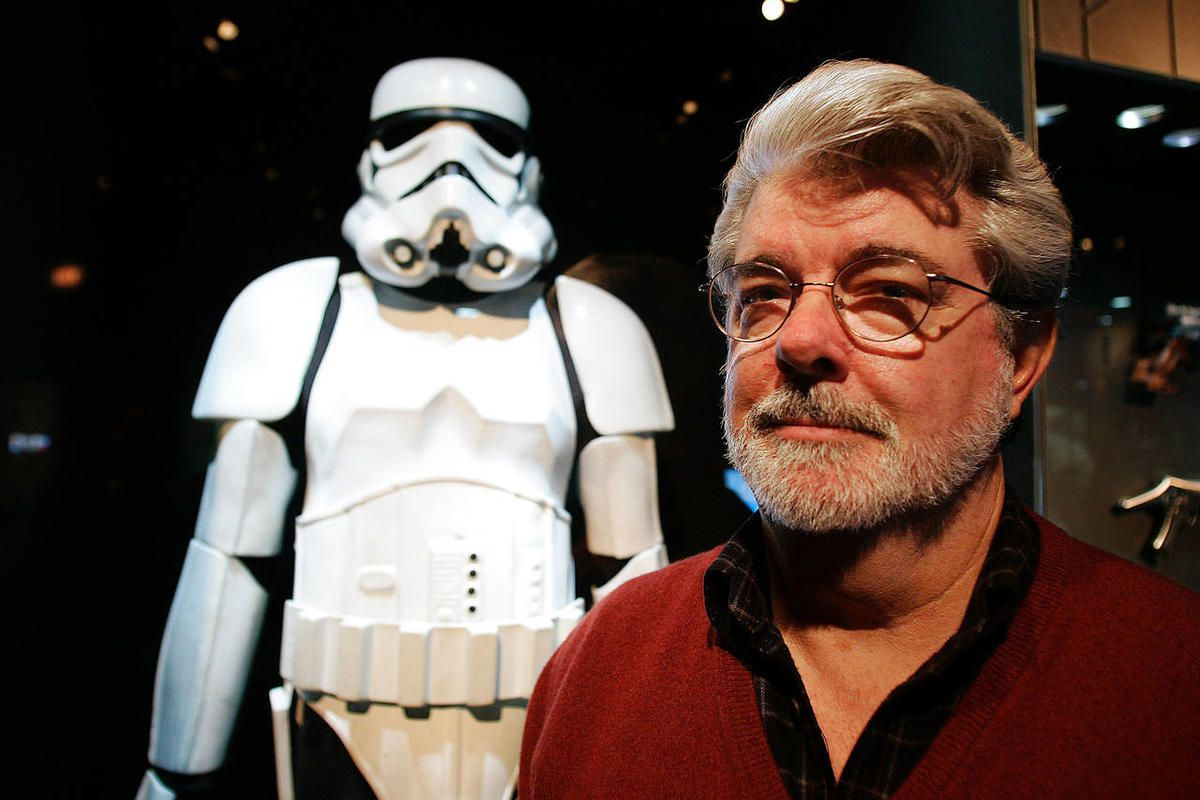 George Lucas pauses in front of a stormtrooper exhibit at the Museum of Science in Boston in 2005.