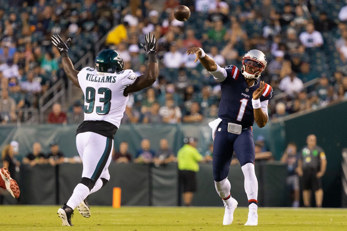 New England Patriots quarterback Cam Newton (1) passes the ball against Philadelphia Eagles defensive tackle Milton Williams (93) during the first quarter at Lincoln Financial Field.