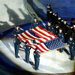 The World Trade Center flag is presented by members of the New York Police and Fire departments at the opening ceremony of the Salt Lake 2002 Winter Games at the University of Utah's Rice-Eccles Stadium on Friday, Feb. 8, 2002.