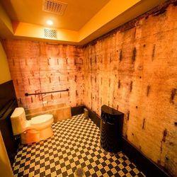 The men's bathroom features Flavor Paper.