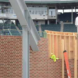 Wooden boards still in place on top of the right-field wall -