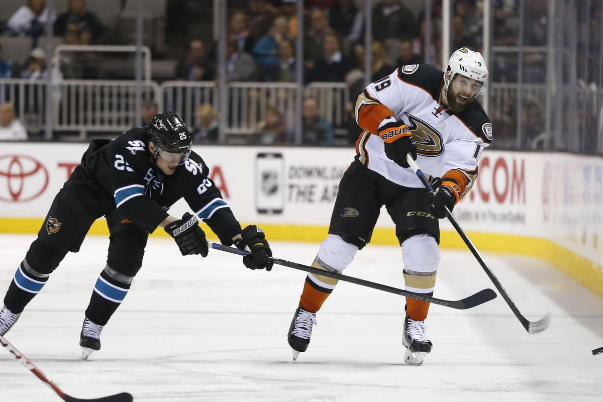 Patrick Maroon chips the puck in last season against the Sharks.