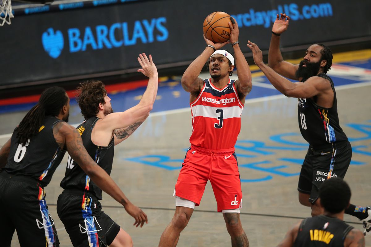 Washington Wizards shooting guard Bradley Beal (3) shoots against Brooklyn Nets center DeAndre Jordan (6) and small forward Joe Harris (12) and shooting guard James Harden (13) and point guard Kyrie Irving (11) during the third quarter at Barclays Center.