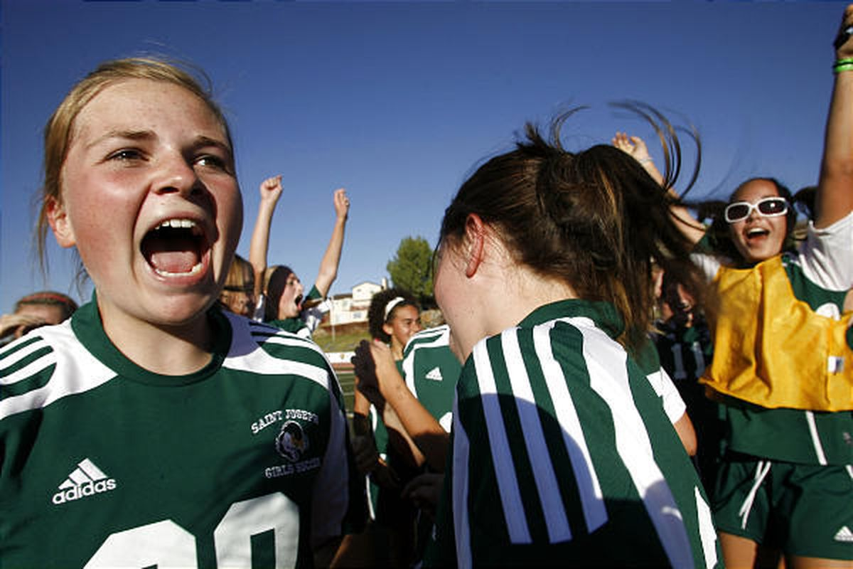 St. Joseph's Meg Baker celebrates the Jayhawks' 2A title-winning victory Saturday.