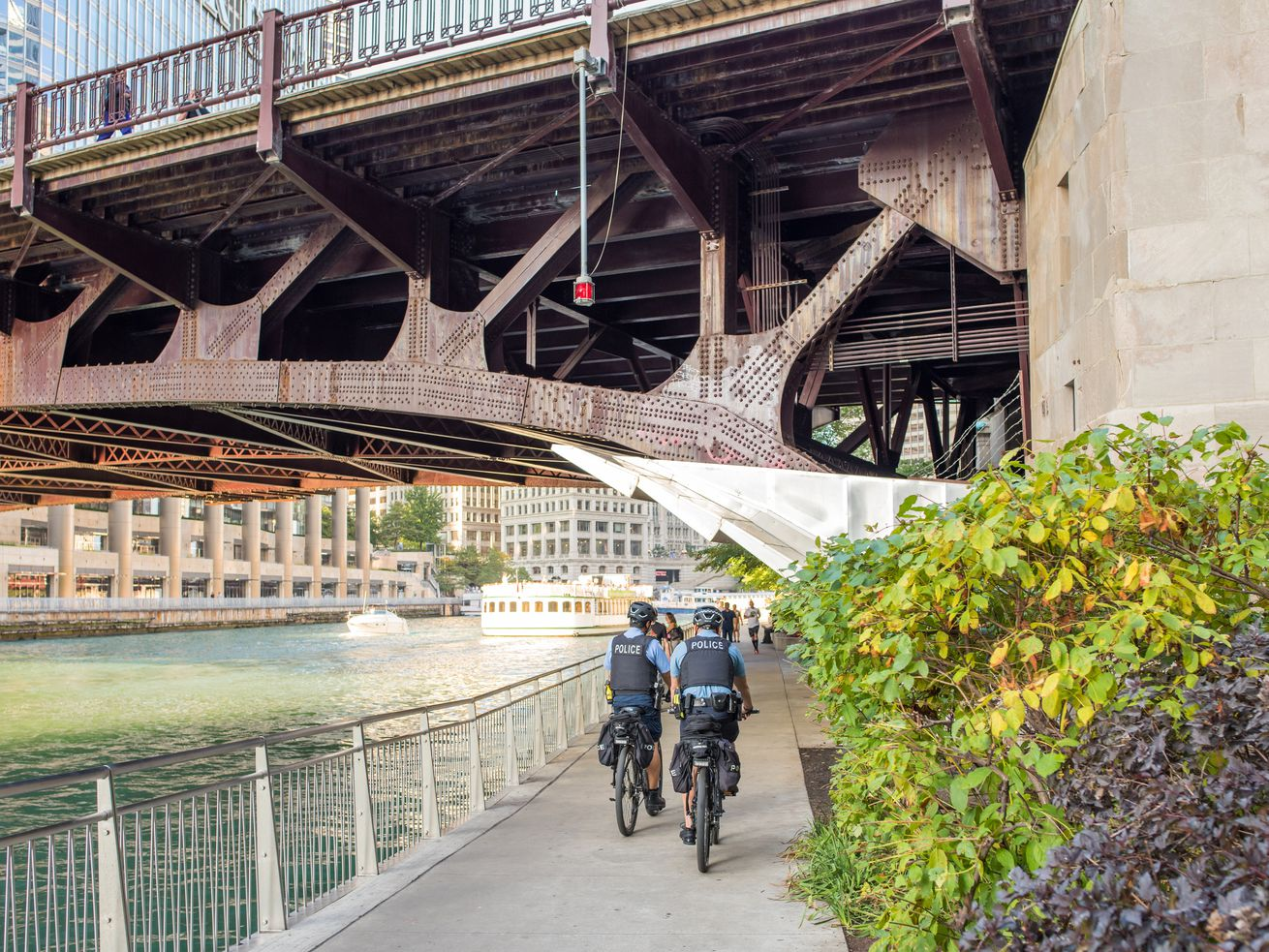 A group of Chicago Police Officers cruise the Riverwalk on bike.