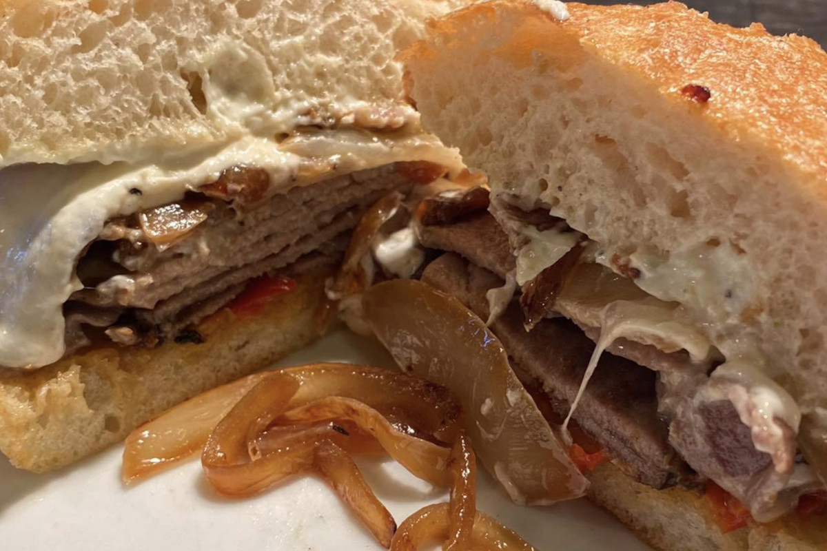 A meaty sandwich with cheese at Martino's