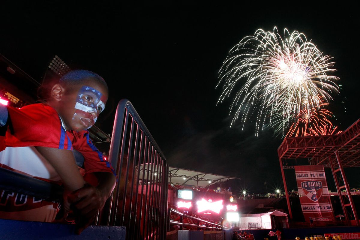 FRISCO, TX - JULY 02:  A young FC Dallas fan watches a fireworks show after FC Dallas beat the Columbus Crew 2-1 at Pizza Hut Park on July 2, 2011 in Frisco, Texas.  (Photo by Tom Pennington/Getty Images)