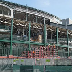 Scaffolding going up, near the main ticket windows, on the south end of Gallagher Way