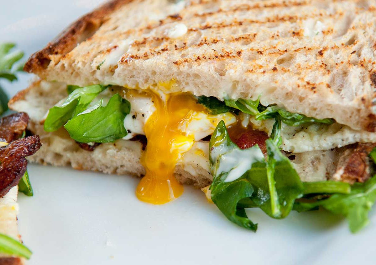 Fried egg sandwich with sunny eggs, crispy Niman Ranch bacon, melted gruyere, fresh arugula, and rich aioli on toasted country bread.