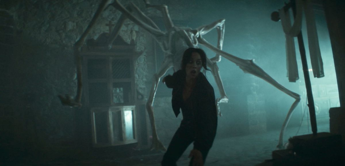 A woman is chased by a giant spider-like monster in 30 Coins