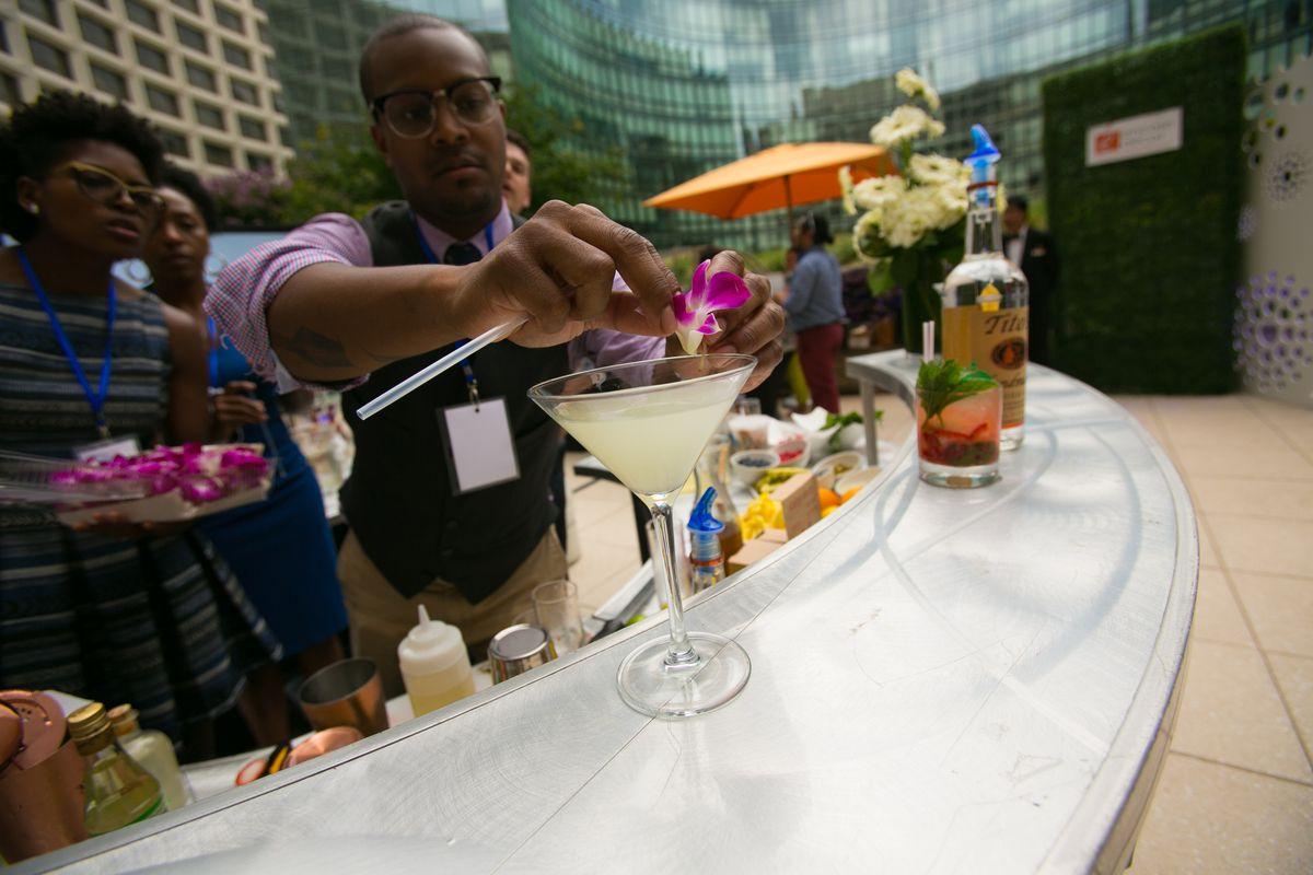 Service Bar DC's Glen Hartley shaking up his Basil Blossom cocktail.