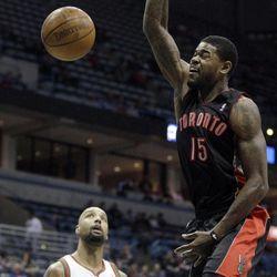Toronto Raptors' Amir Johnson (15) dunks over Milwaukee Bucks' Drew Gooden (0) during the first half of an NBA basketball game Monday, April 23, 2012, in Milwaukee.
