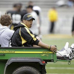 Iowa running back Jordan Canzeri is helped off the field on a cart after Iowa's annual NCAA college football spring scrimmage, Saturday, April 14, 2012, in Iowa City, Iowa. Canzeri was injured during a practice earlier this spring.