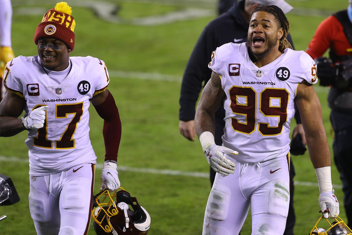 Defensive end Chase Young #99 and wide receiver Terry McLaurin #17 of the Washington Football Team walk off the field after winning 20-14 over the Philadelphia Eagles at Lincoln Financial Field on January 03, 2021 in Philadelphia, Pennsylvania.