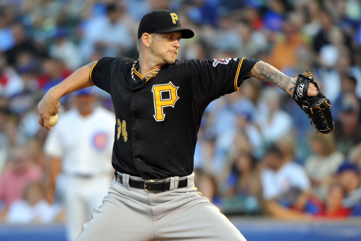 July 31, 2012; Chicago, IL, USA; Pittsburgh Pirates starting pitcher A.J. Burnett (34) delivers a pitch during the first inning against the Chicago Cubs at Wrigley Field.  Mandatory Credit: Rob Grabowski-US PRESSWIRE