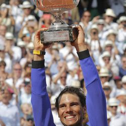 Spain's Rafael Nadal lifts up the cup after defeating Switzerland's Stan Wawrinka in their final match of the French Open tennis tournament at the Roland Garros stadium, Sunday, June 11, 2017 in Paris. Nadal has won his record 10th French Open title, beating No. 3 Stan Wawrinka in straight sets