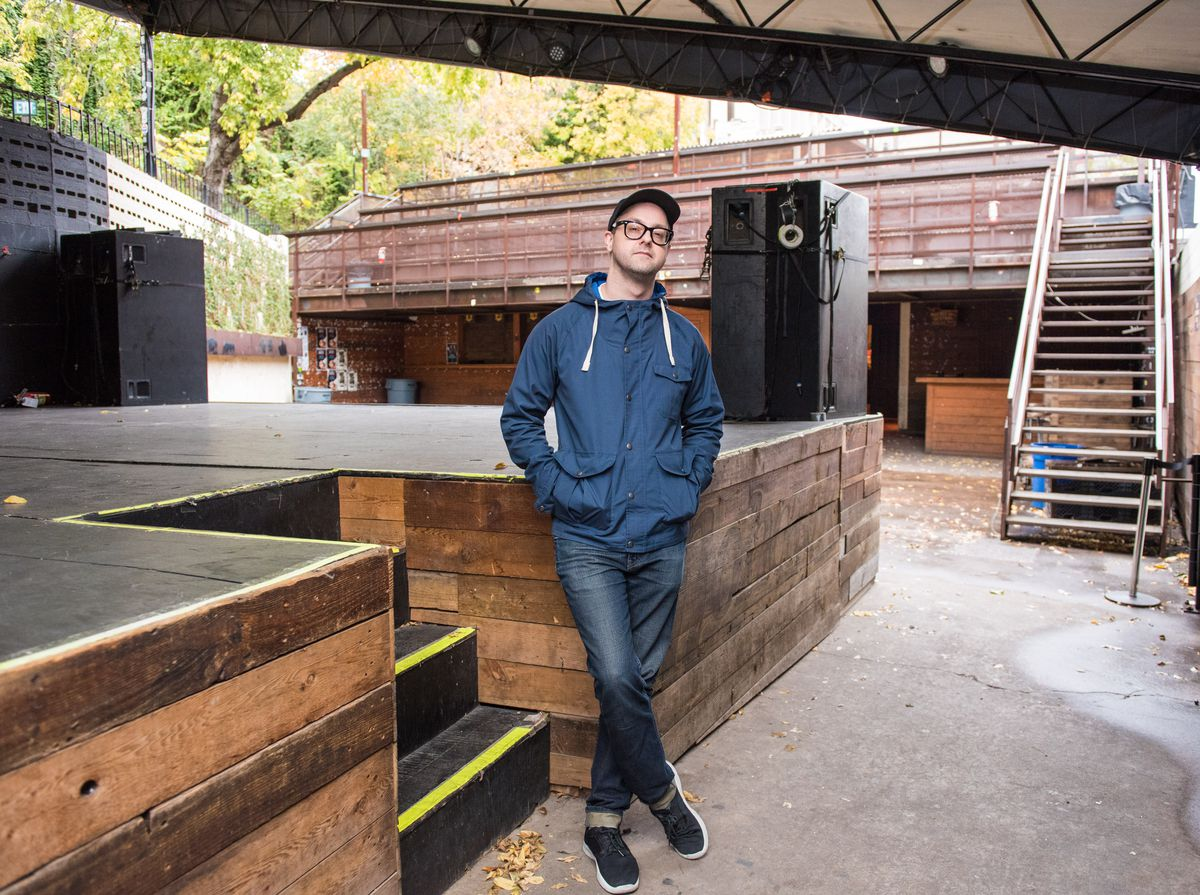Cody Cowan stands next to the stage at the Mohawk, an outdoor venue in Austin.