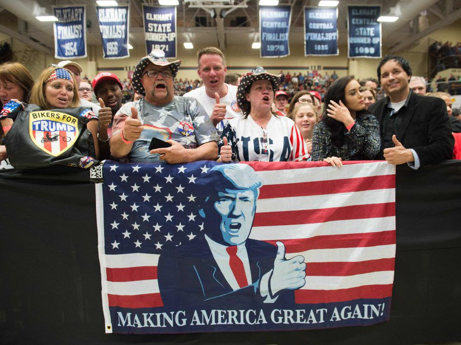 Supporters cheer as President Donald Trump speaks during a rally in Elkhart, Indiana on May 10, 2018. / AFP PHOTO / SAUL LOEB/Getty Images