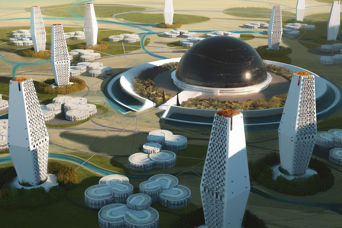 A city cast in white walls with black domes covering its core. The land is green and fertile in between.