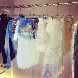Valentina studded denim jacket, $225. Valentina studded denim shorts, $185. Melina bridal lace skirt, $330. Maj bridal lace dress, $530. Mirror leather skirt, $350.