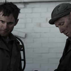 """Actors Matt Meese, left, and Michael Behrens talk in a scene from """"Saints and Soldiers: The Void,"""" directed by Ryan Little and produced by Adam Abel. The film opens in theaters Friday."""