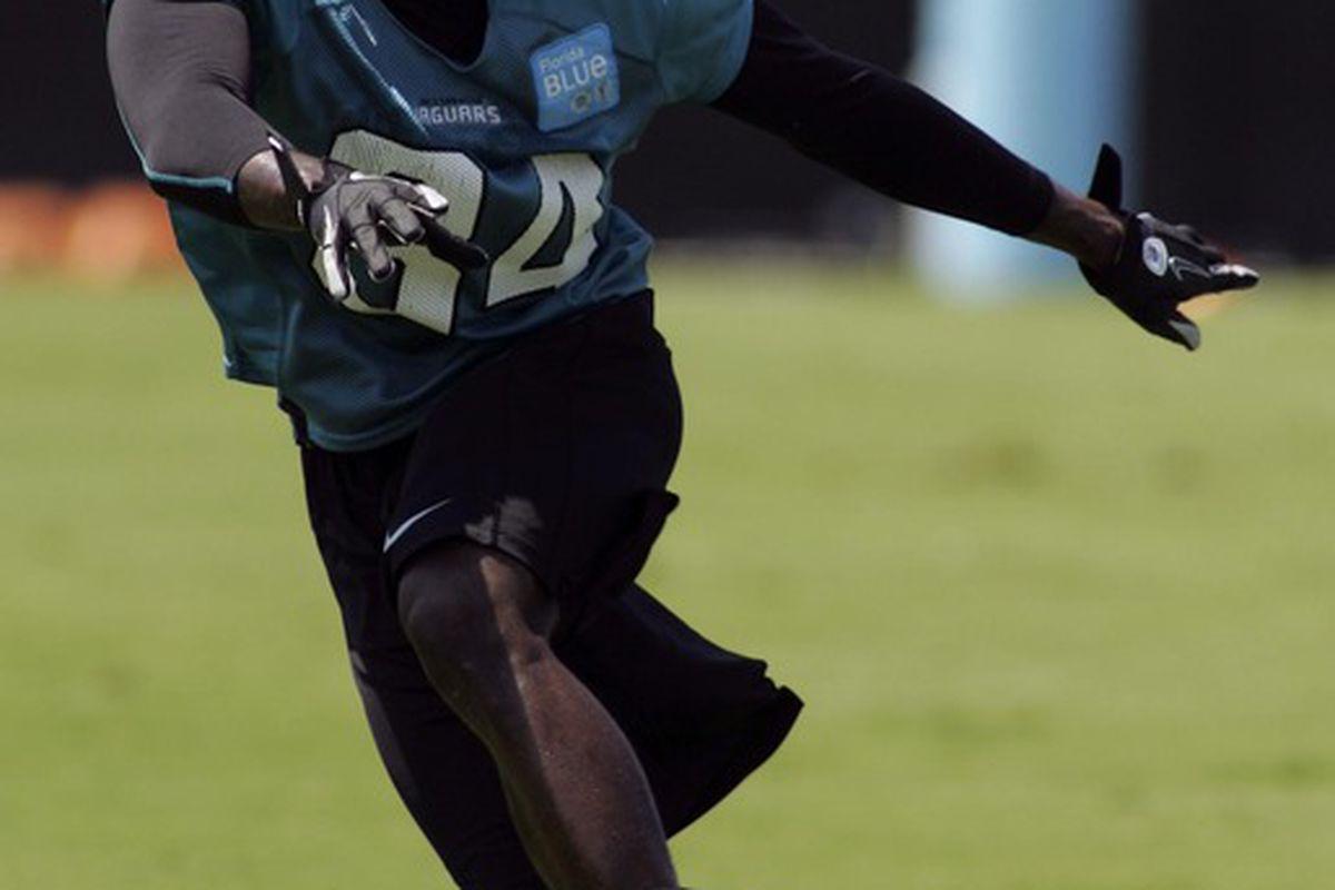 May 6, 2012; Jacksonville FL, USA; Jacksonville Jaguars cornerback Mike Harris (34) works out during rookie mini camp at Florida Blue Health & Wellness Practice Fields. Mandatory Credit: Phil Sears-US PRESSWIRE