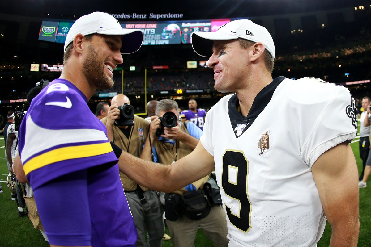 Kirk Cousins of the Minnesota Vikings talks with Drew Brees of the New Orleans Saints after a preseason game at Mercedes Benz Superdome on August 09, 2019 in New Orleans, Louisiana.