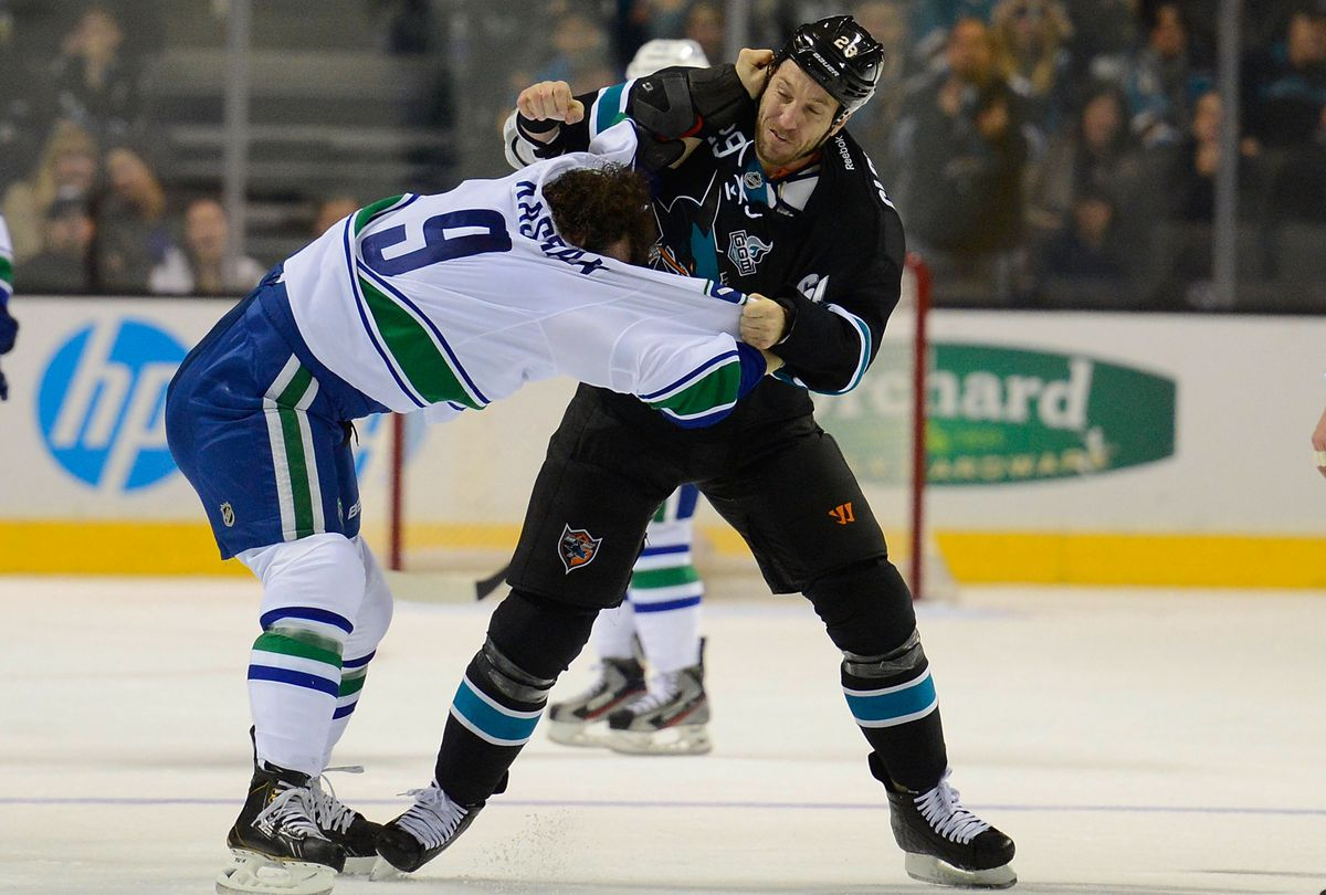 SAN JOSE, CA - JANUARY 27: Ryane Clowe #29 of the San Jose Sharks fights with Zack Kassian #9 of the Vancouver Canucks in the first period of their game at HP Pavilion on January 27, 2013 in San Jose, California.