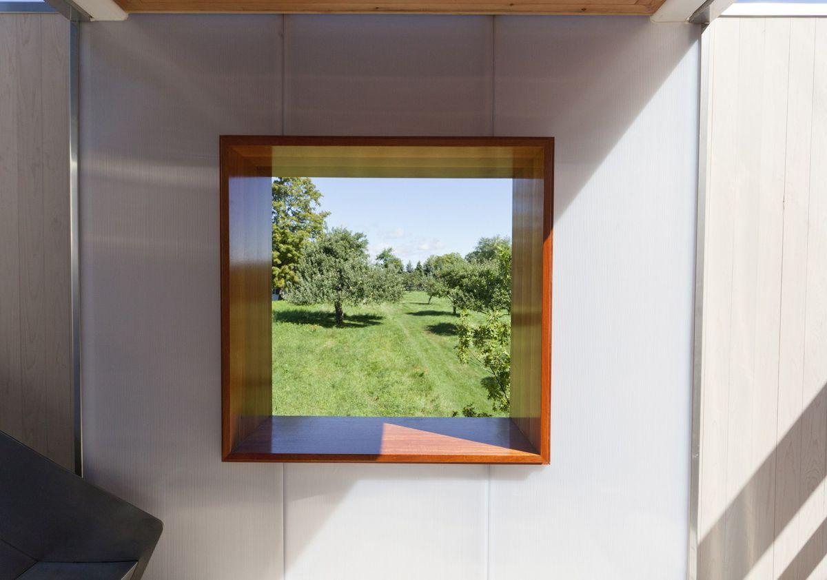Square window overlooking green yard