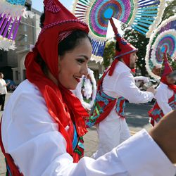 A dancer from the Consulate of Mexico in Salt Lake City dances during the Days of '47 Parade on Friday, July 23, 2021.