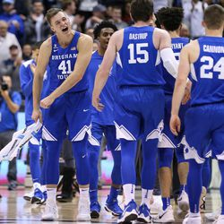 Brigham Young Cougars forward Luke Worthington (41) cheers during the game against the Utah Utes at the Marriott Center in Provo on Saturday, Dec. 16, 2017.