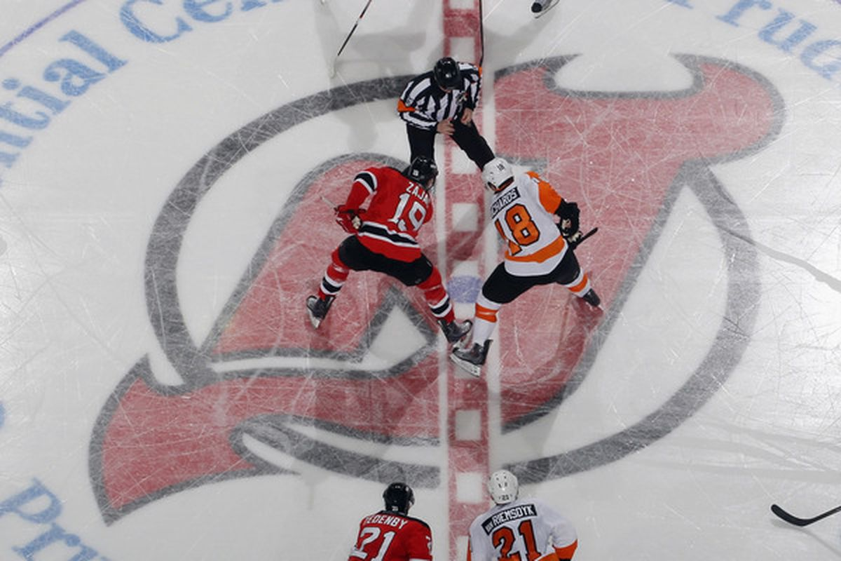 NEWARK NJ - NOVEMBER 27:  The New Jersey Devils faceoff against the Philadelphia Flyers at the Prudential Center on November 27 2010 in Newark New Jersey. The Devils defeated the Flyers 2-1 in the shoot out. (Photo by Bruce Bennett/Getty Images)