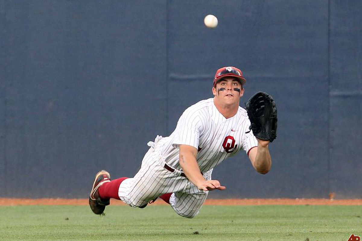 """Oklahoma's Max White went 6-for-8 from the plate on Saturday and made an outstanding diving catch against WVU. Photo via <a href=""""http://nimg.sulekha.com/sports/original700/max-white-2010-6-13-21-6-57.jpg"""">nimg.sulekha.com</a>"""