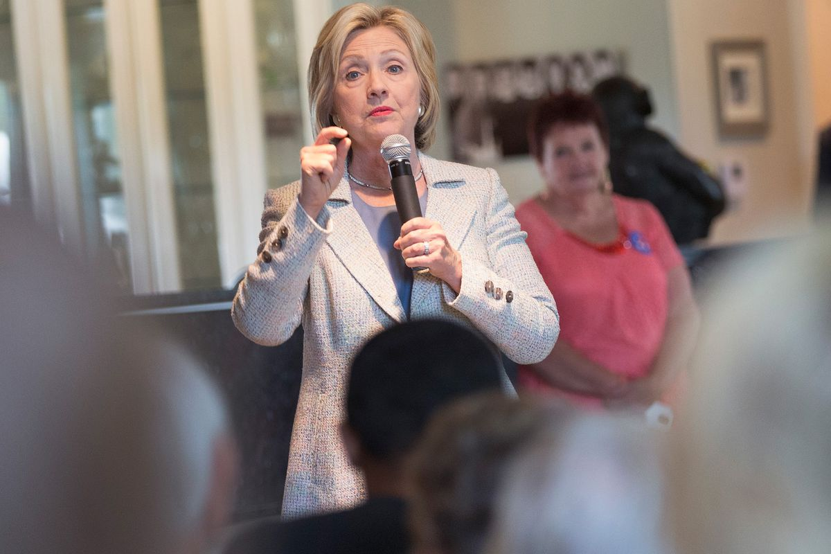 Democratic presidential hopeful and former Secretary of State Hillary Clinton speaks to guests gathered for a house party on July 26, 2015, in Carroll, Iowa.