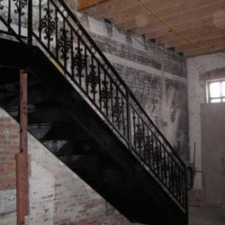 The stairs up to the company's headquarters, which will be located above the restaurant. This staircase will be moved, though, to give the kitchen more space.
