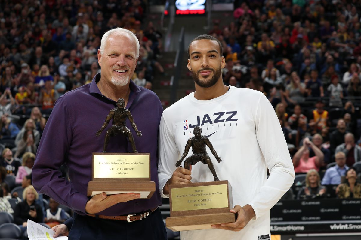 Rudy Gobert and Mark Eaton pose with Rudy's DPOY trophies