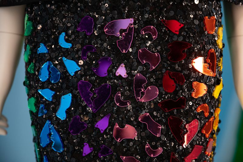 A black sequined skirt with rainbow broken hearts all over it.