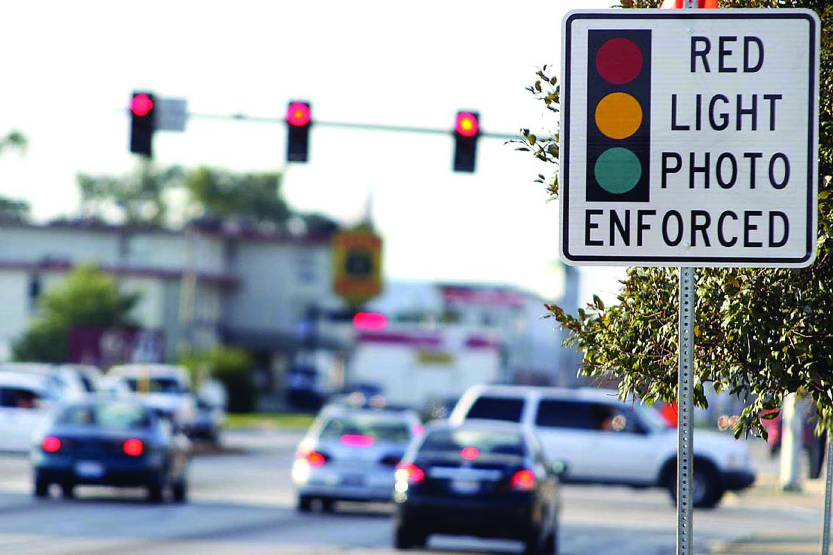 A red light camera enforcement sign on Mannheim Road in Franklin Park in 2008,
