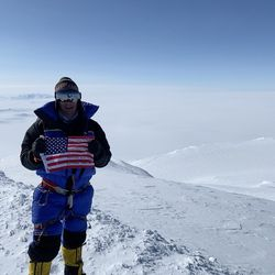 Utahn David Roskelley holds an American flag on the summit of Mount Sidley, the highest volcano in Antarctica.
