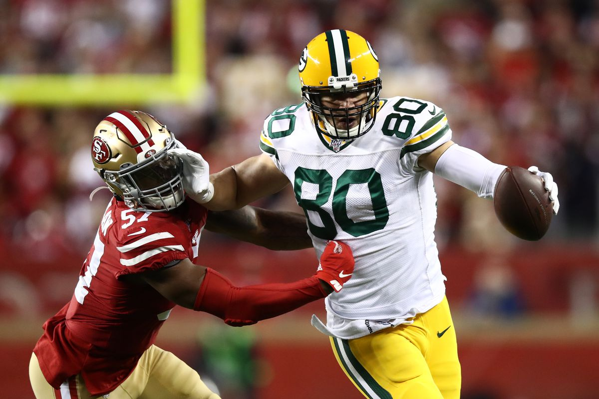 Jimmy Graham #80 of the Green Bay Packers stiff arms Dre Greenlaw #57 of the San Francisco 49ers after a catch during the NFC Championship game at Levi's Stadium on January 19, 2020 in Santa Clara, California.