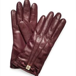 """<strong>Tory Burch</strong> Cashmere Lined Leather Bow Glove, <a href=""""http://www.toryburch.com/Bow-Glove/32125054,default,pd.html?dwvar_32125054_color=553&start=22&q=cashmere#"""">$122.50</a> on sale from $175"""