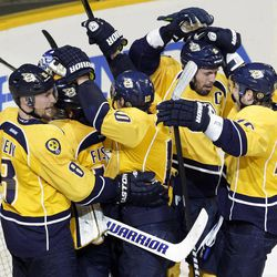 The Nashville Predators celebrate their 2-1 win over the Detroit Red Wings in Game 5 of a first-round NHL Stanley Cup hockey playoff series on Friday, April 20, 2012, in Nashville, Tenn. The Predators won the series 4-1.